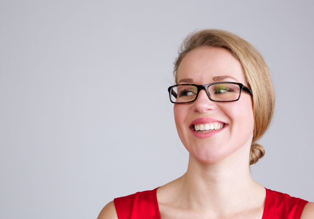Smiling business woman with glasses